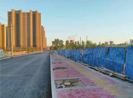 西部会展中心配建2417个车位 5个展馆8月底完成结构施工