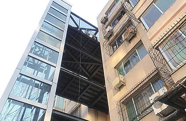 看济南如何破解老楼装电梯难题