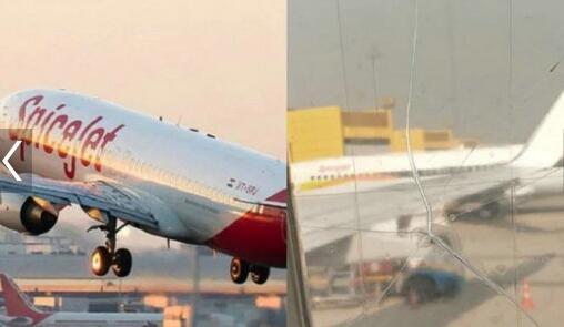 揪心!机窗裂粘后继续飞 机窗上有裂纹贴着透明胶带