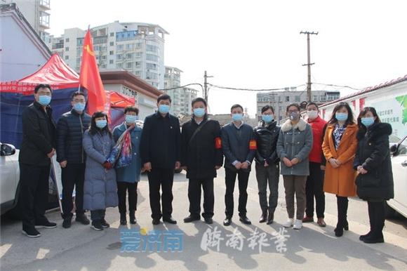 市疫情处置党建保障督导组临时党支部到堤口路街道参加社区主题党日活动
