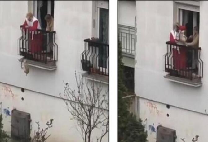欢乐多!塞尔维亚奶奶阳台遛狗 用长绳让狗子空降地面开心玩耍